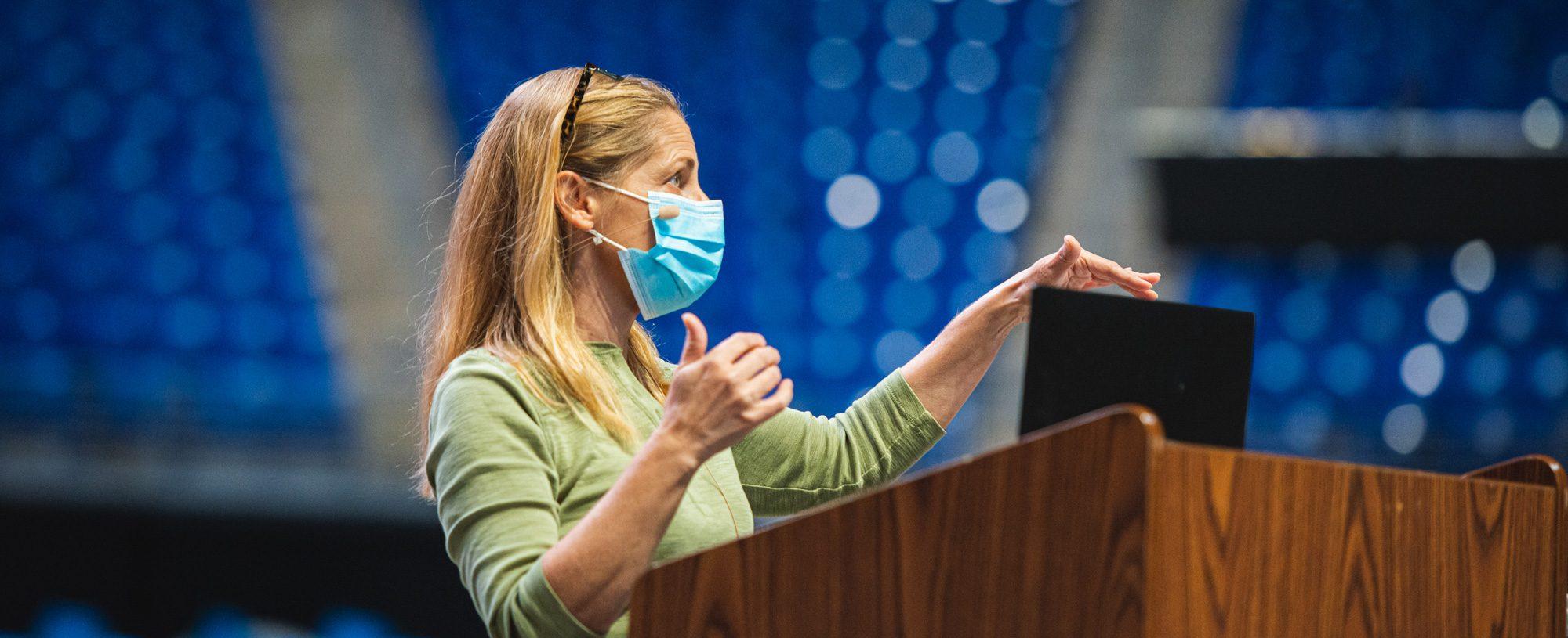 Instructor wearing mask at podium